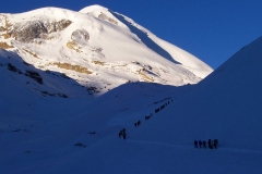 Trekkers-Walking-on-Snow-Covered-Trail
