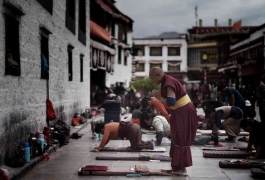A monk praying at a monastery